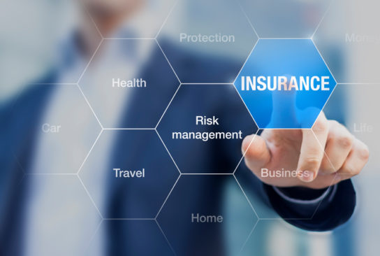 photo of man pointing to a word saying 'insurance'